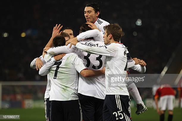 Mario Gomez of Muenchen celebrates his team's first goal with team mates during the UEFA Champions League group E match between AS Roma and FC Bayern...