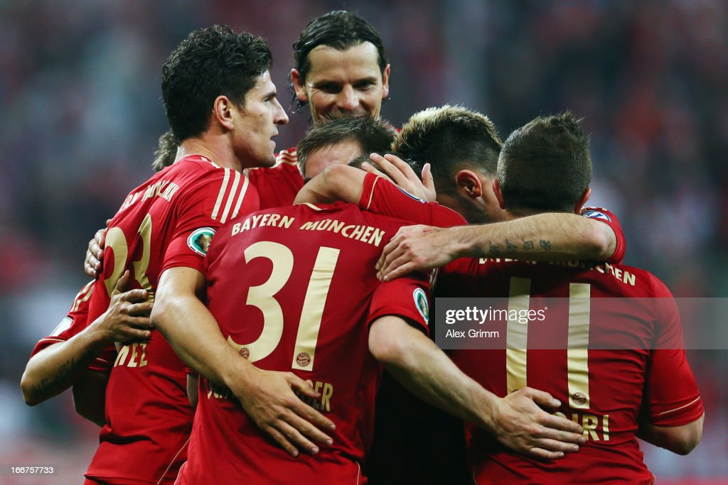 Mario Gomez of Muenchen celebrates his team's fourth goal with team mates during the DFB Cup Semi Final match between Bayern Muenchen and VfL Wolfsburg at Allianz Arena on April 16, 2013 in Munich, Germany.