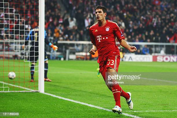 Mario Gomez of Muenchen celebrates his team's second goal during the UEFA Champions League group A match between FC Bayern Muenchen and SSC Napoli at...