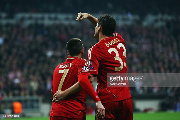 Mario Gomez of Muenchen celebrates his team's sixth goal with team mate Franck Ribery during the UEFA Champions League Round of 16 second leg match...