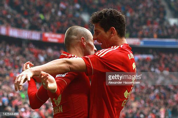 Mario Gomez of Muenchen celebrates scoring his second team goal with his team mmate Arjen Robben during the Bundesliga match between FC Bayern...