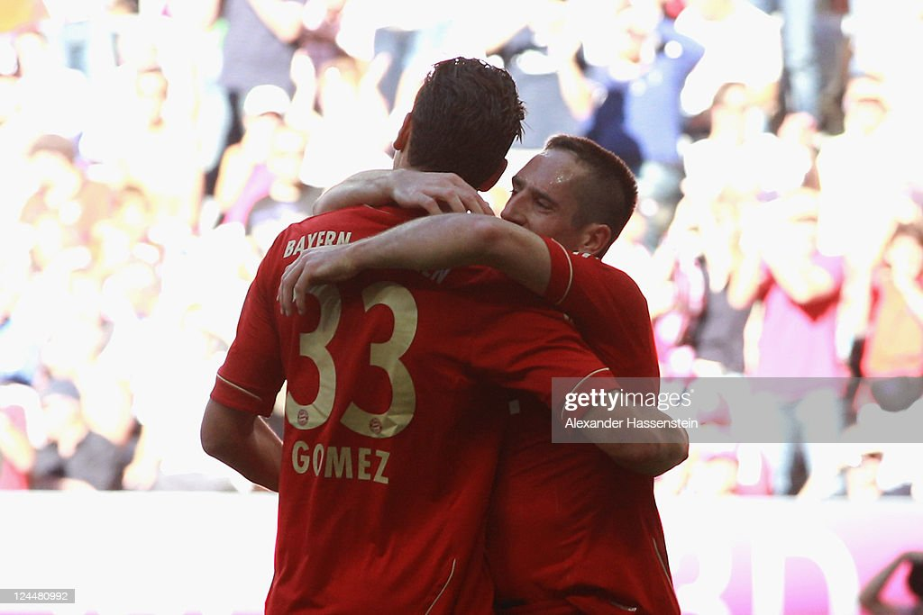 Mario Gomez of Muenchen celebrates scoring the 4th team goal with his team mate Franck Ribery (R) during the Bundesliga match between FC Bayern Muenchen and SC Freiburg at Allianz Arena on September 10, 2011 in Munich, Germany.