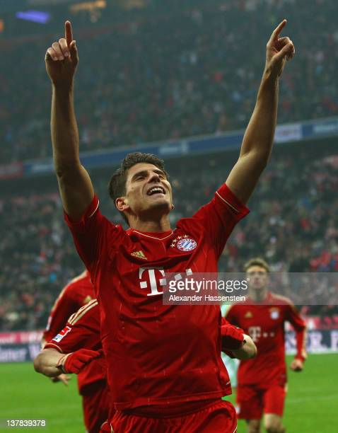 Mario Gomez of Muenchen celebrates scoring the opening goal during the Bundesliga match between FC Bayern Muenchen and VfL Wolfsburg at Allianz Arena...