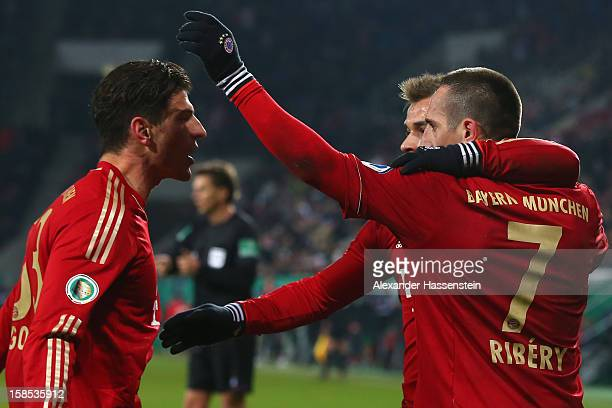 Mario Gomez of Muenchen celebrates scoring the opening goal with his team mates Franck Ribery and Xherdan Shaqiri during the DFB cup round of sixteen...