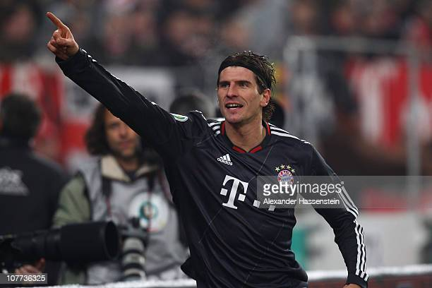 Mario Gomez of Muenchen celebrates scoring the second team goal during the DFB Cup last 16 match between VfB Stuttgart and FC Bayern Muenchen at...