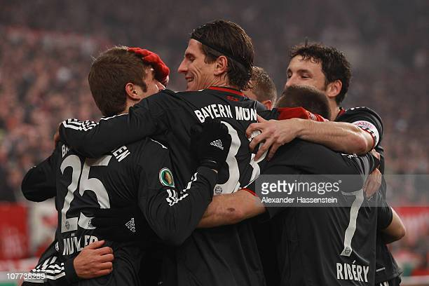 Mario Gomez of Muenchen celebrates scoring the second team goal with his team mates during the DFB Cup last 16 match between VfB Stuttgart and FC...