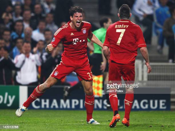 Mario Gomez of Muenchen celebrates with his team mate Franck Ribery after scoring his team's first goal during the UEFA Champions League Quarter...