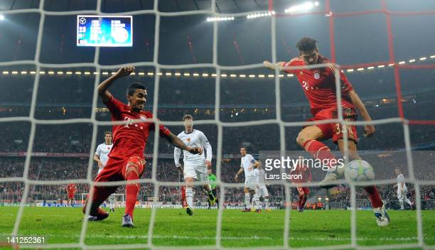 Mario Gomez of Muenchen scores his teams third goal during the UEFA Champions League Round of 16 second leg match between FC Bayern Muenchen and FC...