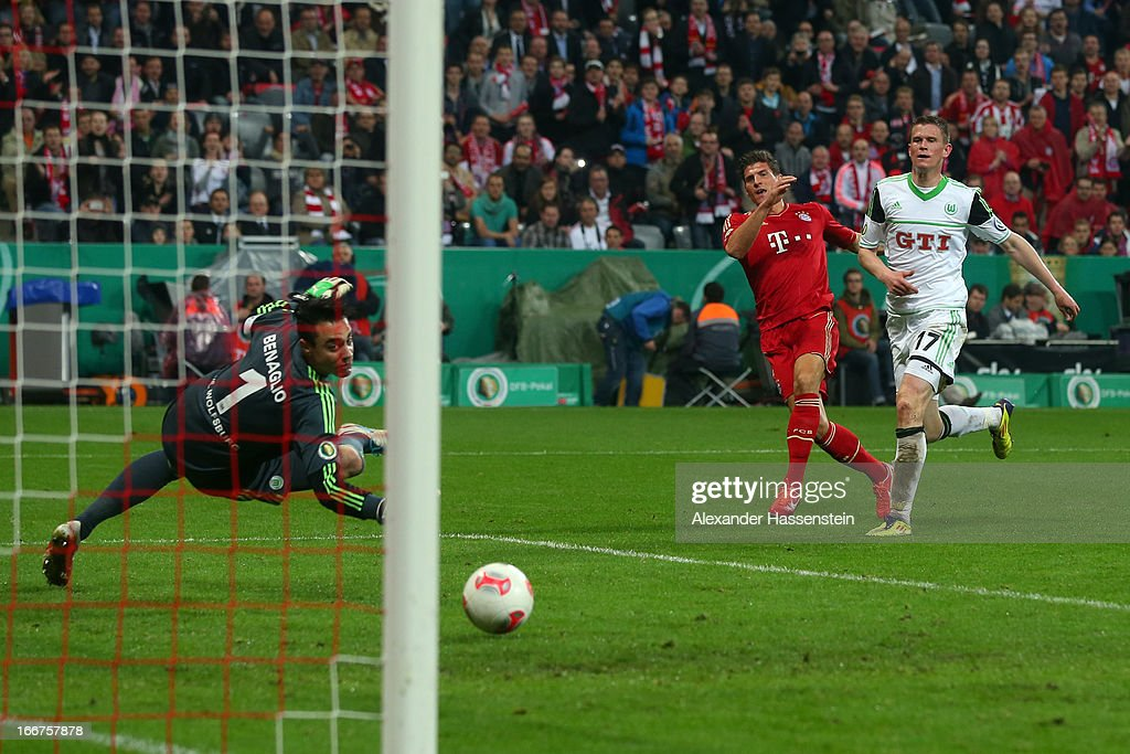 Mario Gomez (C) of Muenchen scores the 6th team goal against Alexander Madlung of Wolfsburg and his keeoer Diego Benaglio during the DFB Cup Semi Final match between Bayern Muenchen and VfL Wolfsburg at Allianz Arena on April 16, 2013 in Munich, Germany.