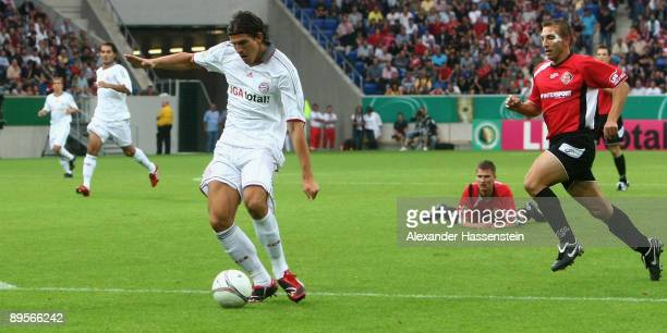 Mario Gomez of Muenchen scores the first goal during the DFB Cup first round match between SpVgg Neckarelz and FC Bayern Muenchen at the...