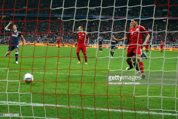 Mario Gomez of Muenchen scores the opening goal during the Bundesliga match between FC Bayern Muenchen and 1. FC Koeln at Allianz Arena on December...