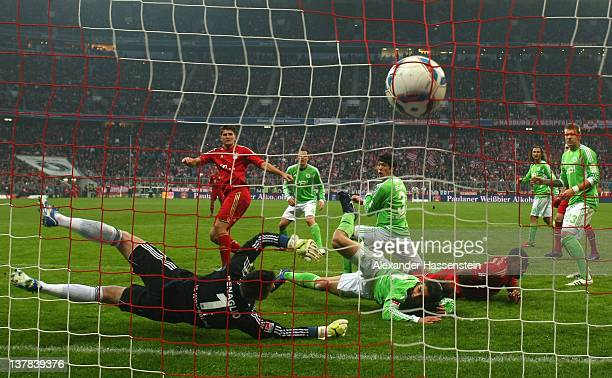 Mario Gomez of Muenchen scores the opening goal during the Bundesliga match between FC Bayern Muenchen and VfL Wolfsburg at Allianz Arena on January...