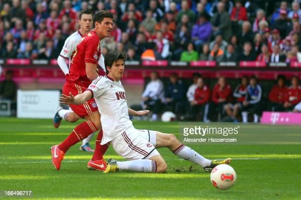 Mario Gomez of Muenchen scores the second team goal against Timm Klose of Nuernberg during the Bundesliga match between FC Bayern Muenchen and 1. FC...