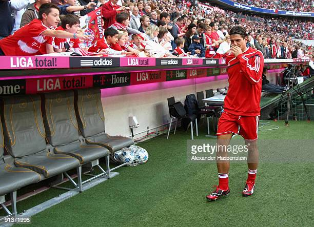Mario Gomez of Muenchen takes place on the team bench during the Bundesliga match between FC Bayern Muenchen and 1 FC Koeln at Allianz Arena on...