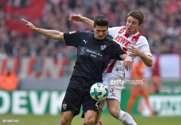 Mario Gomez of Stuttgart and Dominique Heintz of Koeln battle for the ball during the Bundesliga match between 1 FC Koeln and VfB Stuttgart at...