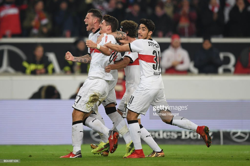 Mario Gomez of Stuttgart (l, 27) celebrates after Niklas Stark of Berlin (not pictured) scored an own goal to make it 1:0 during the Bundesliga match between VfB Stuttgart and Hertha BSC at Mercedes-Benz Arena on January 13, 2018 in Stuttgart, Germany.