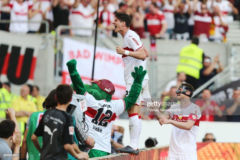 Mario Gomez of Stuttgart celebrates his second goal with Christian Gentner (R) during the Bundesliga match between VfB Stuttgart and TSG 1899 Hoffenheim at Mercedes-Benz Arena on May 5, 2018 in Stuttgart, Germany.