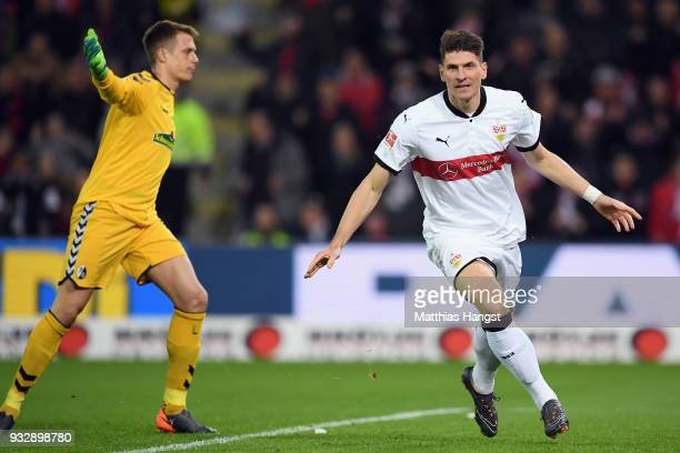 Mario Gomez of Stuttgart celebrates his team's first goal during the Bundesliga match between SportClub Freiburg and VfB Stuttgart at...