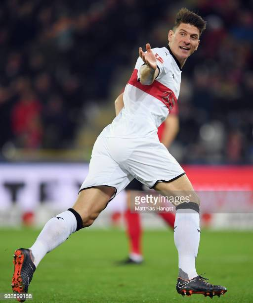 Mario Gomez of Stuttgart celebrates his team's first goal during the Bundesliga match between SportClub Freiburg and VfB Stuttgart at...