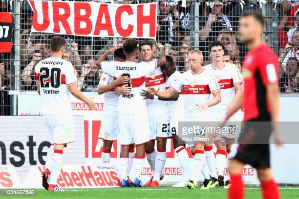 Mario Gomez of Stuttgart celebrates his team's first goal with team mates during the Bundesliga match between SportClub Freiburg and VfB Stuttgart at...