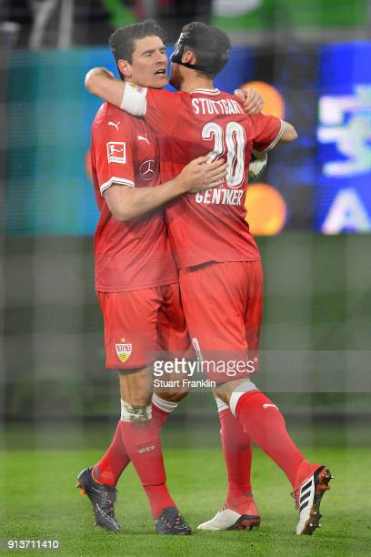 Mario Gomez of Stuttgart celebrates with Christian Gentner of Stuttgart after he scored a goal to make it 11 during the Bundesliga match between VfL...