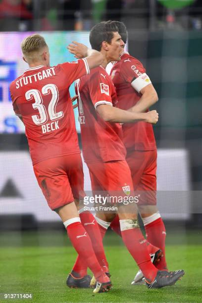 Mario Gomez of Stuttgart celebrates with Christian Gentner of Stuttgart and Andreas Beck of Stuttgart after he scored a goal to make it 11 during the...