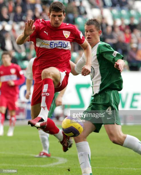 Mario Gomez of Stuttgart challenges for the ball with Alexander Madlung of Wolfsburg during the Bundesliga match between VfL Wolfsburg and VfB...