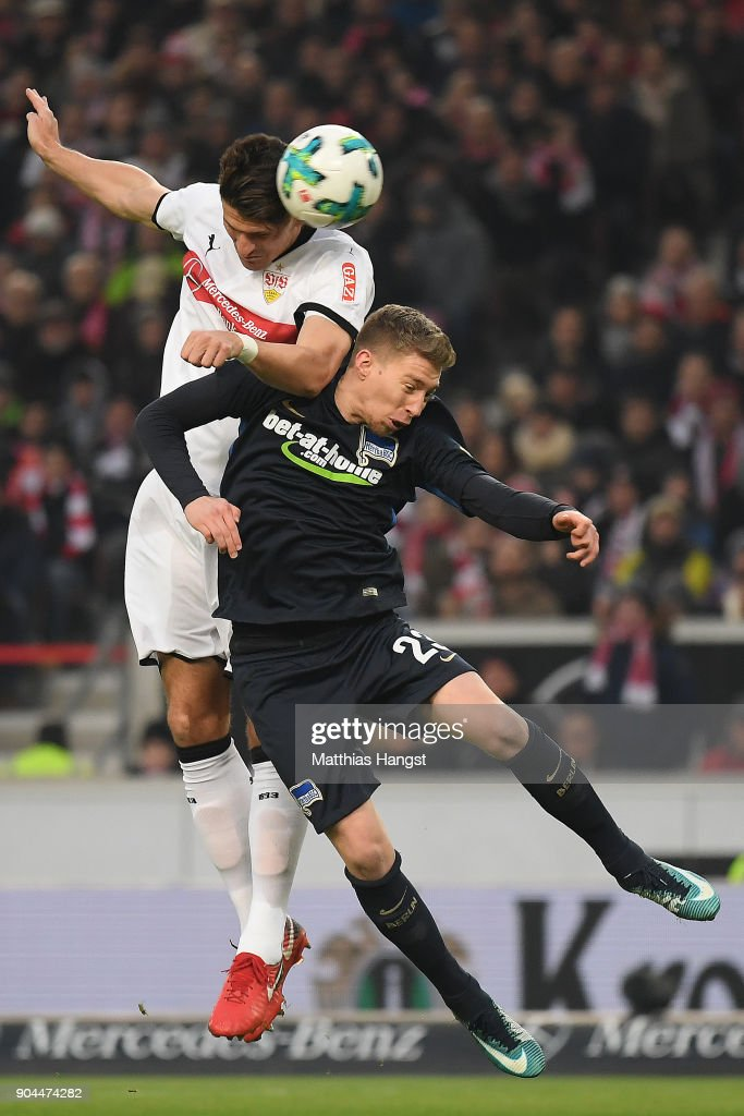 Mario Gomez of Stuttgart (l) fights for the bad with Mitchell Weiser of Berlin during the Bundesliga match between VfB Stuttgart and Hertha BSC at Mercedes-Benz Arena on January 13, 2018 in Stuttgart, Germany.