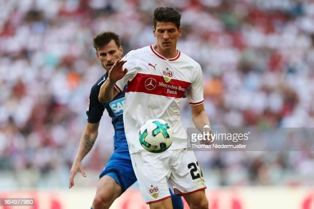 Mario Gomez of Stuttgart fights for the ball with Harvard Nordtveit of Hoffenheim during the Bundesliga match between VfB Stuttgart and TSG 1899...