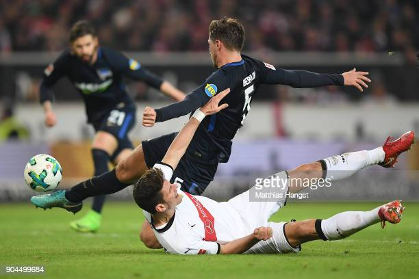 Mario Gomez of Stuttgart fights for the ball with Niklas Stark of Berlin who then scores an own goal to make it 10 during the Bundesliga match...
