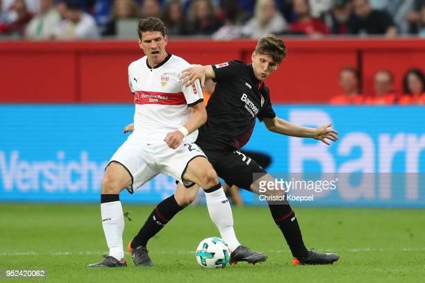 Mario Gomez of Stuttgart fights for the ball with Panagiotis Retsos of Leverkusen during the Bundesliga match between Bayer 04 Leverkusen and VfB...