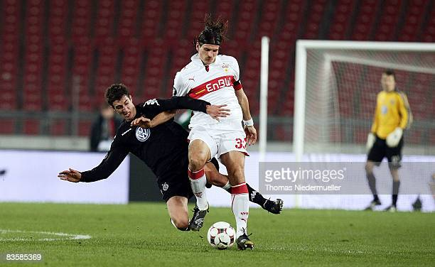 Mario Gomez of Stuttgart fights for the ball with Radosav Petrovic of Belgrad during the UEFA Cup Group C match between VfB Stuttgart and FK Partizan...