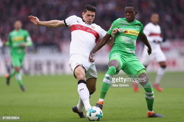 Mario Gomez of Stuttgart is challenged by Denis Zakaria of Moenchengladbach during the Bundesliga match between VfB Stuttgart and Borussia...