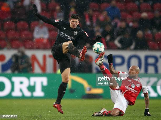 Mario Gomez of Stuttgart is challenged by Nigel de Jong of Mainz during the Bundesliga match between 1 FSV Mainz 05 and VfB Stuttgart at Opel Arena...