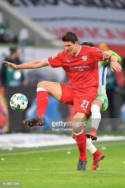 Mario Gomez of Stuttgart is challenged by Renato Steffen of Wolfsburg during the Bundesliga match between VfL Wolfsburg and VfB Stuttgart at...