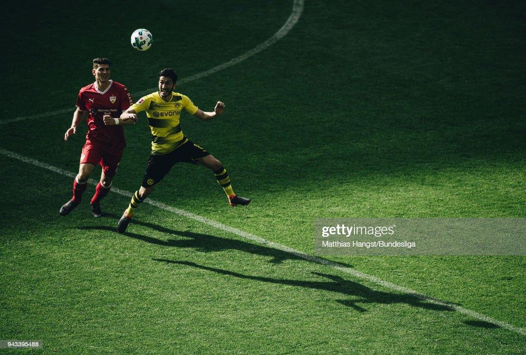 Mario Gomez of Stuttgart jumps for a header with Nuri Sahin of Dortmund during the Bundesliga match between Borussia Dortmund and VfB Stuttgart at Signal Iduna Park on April 8, 2018 in Dortmund, Germany.