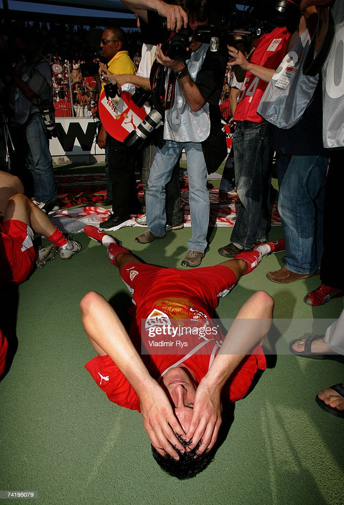 Mario Gomez of Stuttgart lays on the floor during celebrations after winning the German championship after the Bundesliga match between VfB Stuttgart and Energie Cottbus at the Gottlieb Daimler stadium on May 19, 2007 in Stuttgart, Germany.