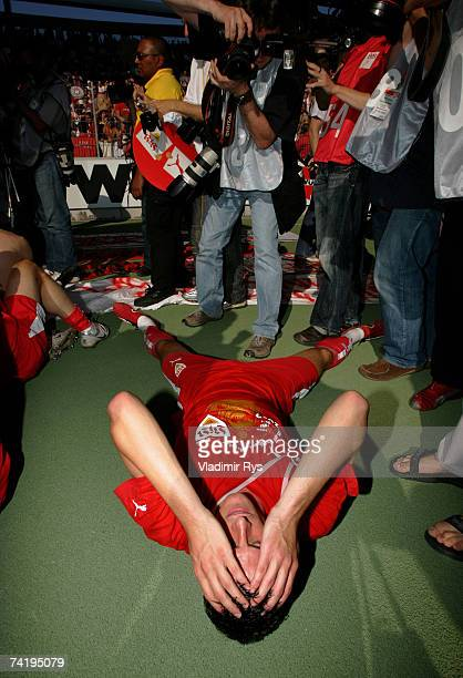 Mario Gomez of Stuttgart lays on the floor during celebrations after winning the German championship after the Bundesliga match between VfB Stuttgart...