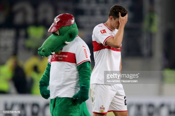Mario Gomez of Stuttgart reacts next to Stuttgart's mascot Fritzle after the Bundesliga match between VfB Stuttgart and Eintracht Frankfurt at...