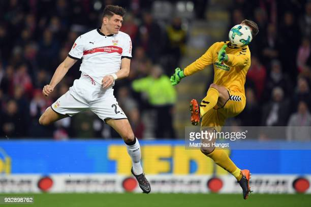 Mario Gomez of Stuttgart scores his team's first goal past goalkeeper Alexander Schwolow of Freiburgduring the Bundesliga match between SportClub...