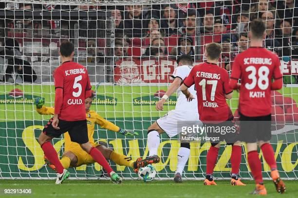 Mario Gomez of Stuttgart scores his team's second goal during the Bundesliga match between SportClub Freiburg and VfB Stuttgart at SchwarzwaldStadion...