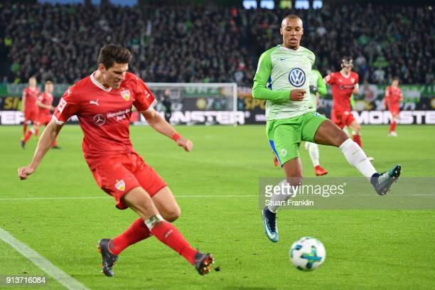 Mario Gomez of Stuttgart shoots past Marcel Tisserand of Wolfsburg during the Bundesliga match between VfL Wolfsburg and VfB Stuttgart at Volkswagen...