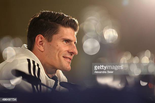 Mario Gomez of the German national soccer team smiles during a press conference on November 10 2015 in Munich Germany
