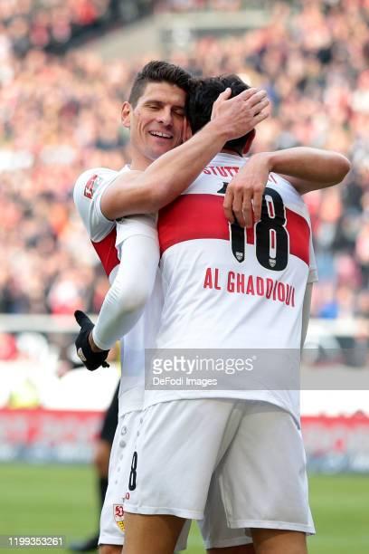 Mario Gomez of VfB Stuttgart and Hamadi Al Ghaddioui of VfB Stuttgart celebrates after scoring his team's third goal with team mates during the...