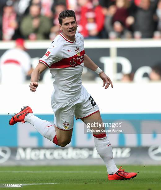 Mario Gomez of VfB Stuttgart celebrates after scoring his team`s first goal during the Bundesliga match between VfB Stuttgart and Hannover 96 at...