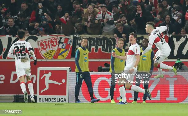 Mario Gomez of VfB Stuttgart celebrates after scoring his team's second goal with his team mates during the Bundesliga match between VfB Stuttgart...