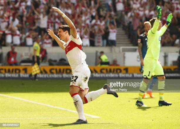 Mario Gomez of VfB Stuttgart celebrates after scoring the first goal while Oliver Baumann of 1899 Hoffenheim is dejected during the Bundesliga match...