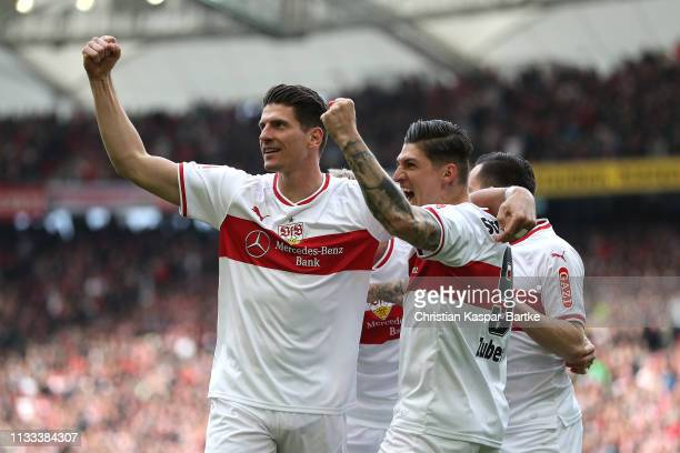 Mario Gomez of VfB Stuttgart celebrates with team mate after he scores his sides first goal during the Bundesliga match between VfB Stuttgart and...