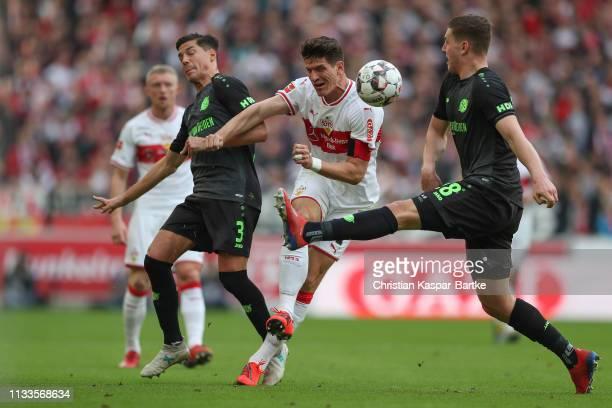 Mario Gomez of VfB Stuttgart challenges Kevin Wimmer of Hannover 96 during the Bundesliga match between VfB Stuttgart and Hannover 96 at...