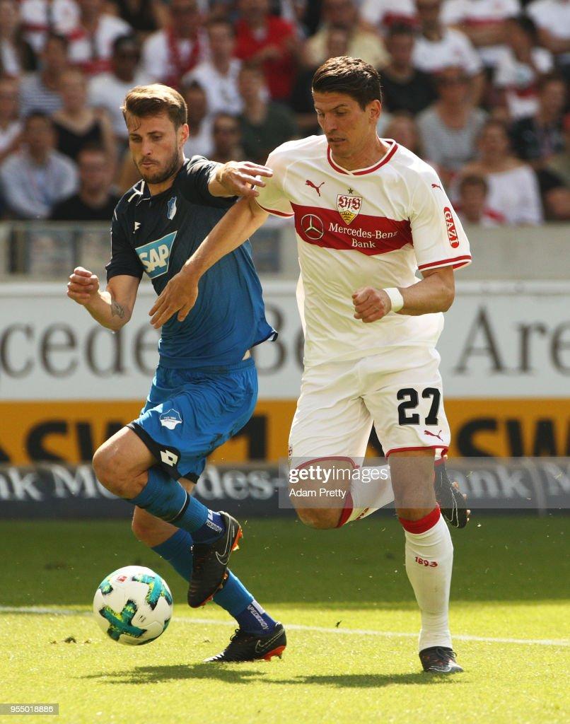 Mario Gomez of VfB Stuttgart is challenged by Havard Nordtveit of 1899 Hoffenheim during the Bundesliga match between VfB Stuttgart and TSG 1899 Hoffenheim at Mercedes-Benz Arena on May 5, 2018 in Stuttgart, Germany.